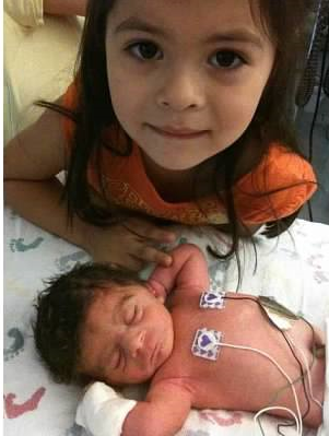 cropped preemie andrew with sister feb 2016